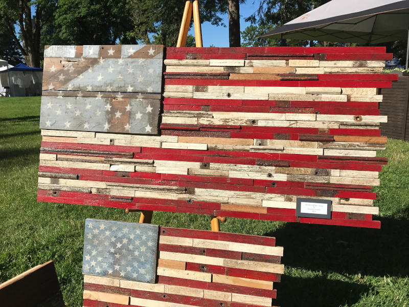 two wooden american flags
