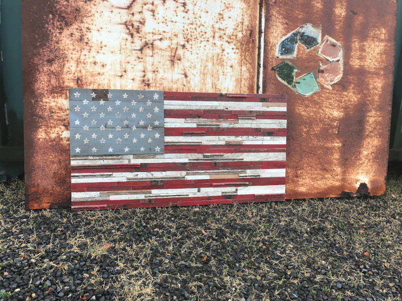 american flag in front of rusty background with recycle logo